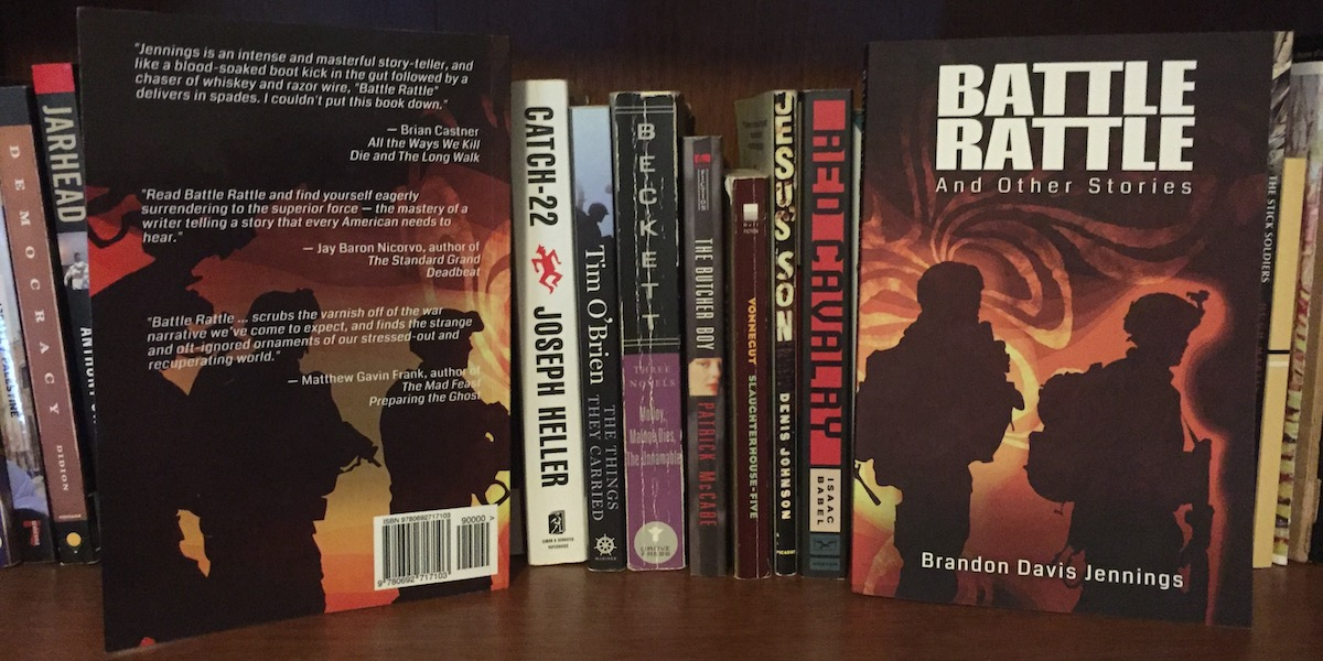 Printed copy of Battle Rattle on a bookshelf
